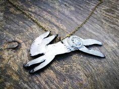 British leaping hare fossil pendant with 18 bronze alloy