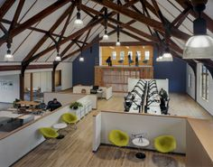 ZGF Architects has designed a new headquarters and production facility for CID Bio-Science, Inc. in a historic, wood-framed, former American Legion Hall on the brink of disrepair. Office Break Room, Office Workspace, Meeting Hall, Workspace Inspiration, Design Inspiration, Interior Architecture, Interior Design, Office Floor, Contemporary Office