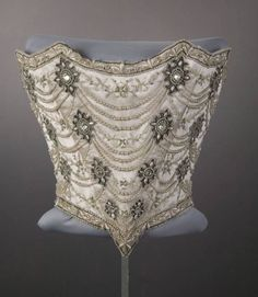 Ornate wedding bodice (white silk taffeta, satin, and tulle with silk embroidery and silver mesh, rhinestone, pearl, and silver cording embellishment), by Weeks, American (Chicago), 1896. Worn as part of ensemble (with inner bodice, skirt, stockings, shoes, and wreath) by Florence Sanger Pullman for her wedding to Frank Orren Lowden on April 29, 1896.