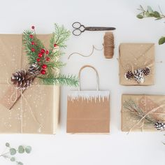 Hark back to a simpler Christmas and utilise a bit of nature in your gift wrapping, for a simple but elegant touch. Add texture to your snowy kraft gift wrap by incorporating lots of greenery and pinecones, whether faux or fresh, and plenty of twine.