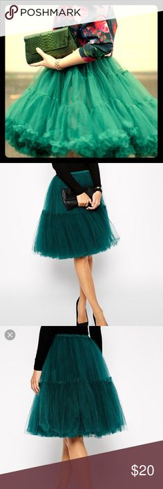 Green tulle skirt Tulle skirt that is a forest green color. Skirt is completely see through. In excellent condition. Asos brand size 6 but it has an elastic waist so it can stretch up to USA size 10 ASOS Skirts