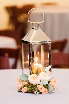 wedding table decor ideas, wedding lanterns inspiration, chic and fabulous wedding flowers ideas Lantern Centerpiece Wedding, Wedding Lanterns, Centerpiece Decorations, Wedding Reception Decorations, Table Centerpieces, Wedding Lighting, Silver Lanterns, Peach Wedding Centerpieces, Centerpiece Flowers
