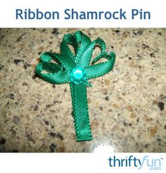 If you need a bit of the green to wear this St. Patrick's Day, try making this simple shamrock pin. This page contains instructions for making a ribbon shamrock pin.
