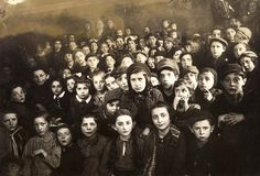 Children during a Purim celebration in Wieliczka, Poland, 1942. Their gaunt faces and the haunted look in their eyes reflect the reality they were living in. Many men fled the town with the approach of the Germans in 1939. More men were murdered when the Germans arrived.
