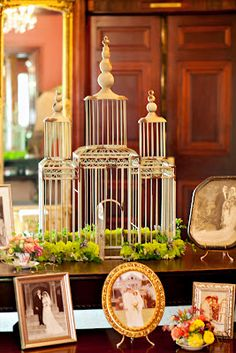 Gorgeous large birdcage wedding décor, surrounded by photos