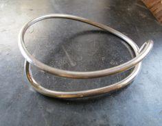 Asymmetrical silver bangle