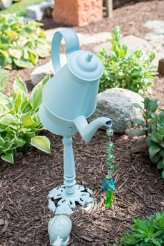DIY garden decor | Upcycled & Repurposed garden decor | Spray painted metal teapot turned into whimsical garden decor | Dollar store crafts | Whimsical fairy gardens | Rust Oleum Robin\'s egg color | Transformed gardens with cheap & easy DIY and crafts | Before & After | TheNavagePatch.com