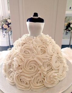 Can you imagine how pretty this wedding dress cake would look as the centre piece at your Bridal Shower? Even the hardest to please future mother-in-law would have to admire it's elegance!! Icing roses and fondant OmNomNom!! Made by Jilly Plot ❤ http://cakecentral.com/g/i/3118227/my-sister-in-laws-bridal-gown-cake/ ❤ Wedding Dress Cake ❤ Gown Cake ❤ Bridal Shower Cake ❤