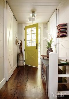 Yellow door.  entry classic and quirky.  Atlanta Homes via The Inspired Room