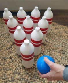 Design a fun indoor game for the kids with our DIY bowling game craft. Upcycle water bottles, fill them with sand and have family fun decorating the pins. - Everyday Dishes & DIY