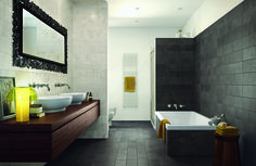 Using two different coloured tiles from the Tudor ranges stops this bathroom from looking too dark, and the pops of yellow create a bright and fun feel.