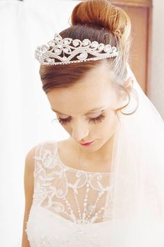 The bride collecting her thoughts & gathering her emotions minutes after dressing.