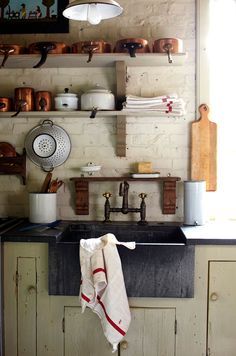 The farm sink is what I love the most, I wonder if the sink is made of soapstone. Photo by Brie Williams.