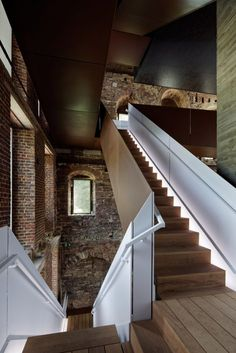 Binario Architectes has used a simple palette of concrete, wood and pre-rusted steel in a series of new additions to Villers Abbey in Belgium, including a new staircase inside the visitor centre.