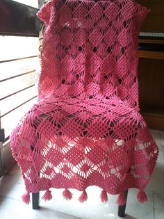 Well, the idea of covering a chair with a piece of crocheted bed cover! this is a Spider stitch shawl