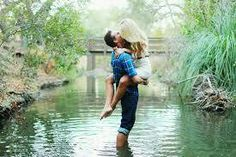 Carrying his lady into the water