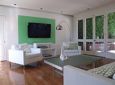 White Modern Room with Green Accent Tv Unit Furniture, Grey Furniture, Living Room White, Home Living Room, Bright Paint Colors, Hollywood Hills Homes, Guest Room Office, Block Wall, Modern Room