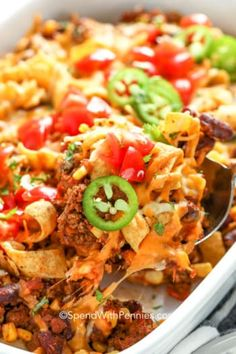 Frito Pie is an easy authentic dinner idea that can be ready in under an hour! Seasoned beef beans tomatoes corn and cheese baked with Fritos. Top with salsa sour cream or guacamole! Green Chili Recipes, Best Chili Recipe, Beef Recipes, Mexican Food Recipes, Cooking Recipes, Dinner Recipes, Mexican Meals, Copycat Recipes, Dinner Ideas