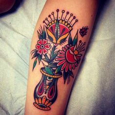 Traditional flower vase tattoo.