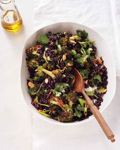 Black Rice and Broccoli with Almonds - This grain salad brings together so many of our favorite ingredients: black rice, roasted broccoli, toasted almonds, fresh parsley, and scallions. A creamy roasted garlic vinaigrette ties all the flavors together beautifully. Garlic, roasted until meltingly soft, lends a creamy texture to this salad's vinaigrette.