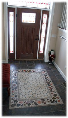 "Wow, an extraordinary use of those leaf tiles. A tiled ""rug"". From website: ""Our client Stacy S. from Traverse City, Michigan, created this incredible ceramic tile foyer / entry rug floor design with a few square feet of leaf tiles."""