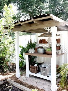 Potting Bench, some new & some old building elements including recycle architectural goodies. Covered with new fiber cement roofing sheet panels.  #gardening shed,