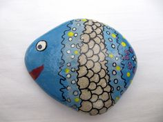 Hand Painted Stone. Would make a good game marker.. or addition to a flower pot...