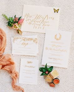A Romantic, Urban Wedding in Austin, TX | Martha Stewart Weddings - Whitney Farnsworth Calligraphy & Design created the couple's elegant, off-white stationery suite using gold metallic ink and a hand-drawn wreath.