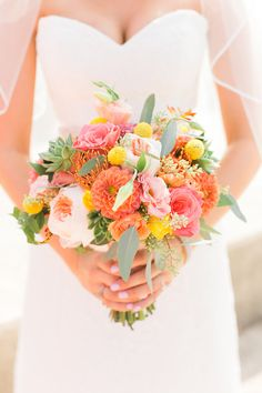 bright bridal bouquet - photo by Artistrie Co http://ruffledblog.com/coral-wedding-with-a-flower-ceremony-backdrop