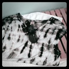 Xcvi Tie Dye top. Nwt! Black& white L Brand new top by xcvi.  New with tags. Great concert tee. Black and white tie dye. Size large. 100% rayon. Very top section of the back sheer viscose. Open to offer. Sorry, no trades. Thanks! XCVI Tops Tees - Short Sleeve