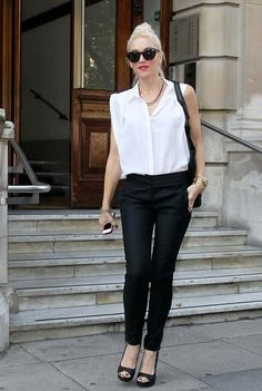 Gwen Stefani traded in her customary harem pants for a pair of elegant black skinny slacks.