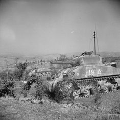 Two Sherman tanks of 6th Royal Tank Regiment in action against German machine-gun positions on the walls of San Marino, 19 September 1944.