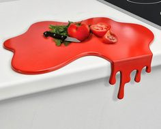 The blood splatter cutting board is a mis-shaped cutting board that looks like a pool of blood after you murdered your spouse with a butcher's knife and it is now pouring down the side of the counter,...