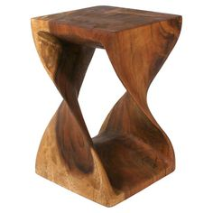 Hand-carved sustainable wood end table.    Product: End tableConstruction Material: Sustainable hardwoodC...