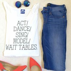 "NWT ""Act/Dance/Sing/Model/Wait Tables"" T-Shirt HOST PICK! Summer Staples party!! NO TRADES. OFFERS WELCOME. PLEASE USE THE OFFER BUTTON. I DO NOT NEGOTIATE PRICE IN THE COMMENTS. The truth about L.A. on a tee. Relaxed, boxy fit. 21"" long, 25"" across at bustline. New, with tags. Never worn. 50% cotton, 50% polyester. Local Celebrity Tops Tees - Short Sleeve"