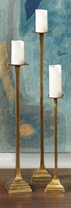 Soaring and statuesque, our Set of Three Vintage Candlesticks transcends simple decorative accent status to create a grand presence wherever you place them.