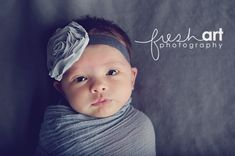 : Love the lighting. I love the baby's connection to the camera and the simplicity of this baby portrait :