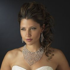 This U shaped silver plated necklace with bursts of crystal rhinestones in a scalloped shaped design will take your guests breath away. This set including earrings and this glamorous necklace is perfe
