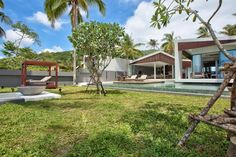 Hotels & Resort, Marvellous Beach Villa Exterior Design Featuring Green Grass And Plants Swimming Pool Terrace Lounge Chairs Coconut Tree Concrete Porch Glass Window Flat Roof: Beach Villa Design in Open and Natural Concept besides Sea Panorama