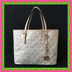 """Authentic Michael Kors Logo Handbag % AUTHENTIC ✨ This is a beautiful and classic logo handbag from Michael Kors Lightweight & very spacious. Length 17"""" Height almost 12"""" Width 7' Strap drop 9 1/2"""" Pocket and a D ring inside Yellow gold tone hardware  New with tag✨ NO TRADE Michael Kors Bags Totes"""