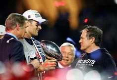 To the victors - Game MVP Tom Brady, team owner Robert Kraft, and head coach Bill Belichick of the New England Patriots celebrate with the Vince Lombardi Trophy after defeating the Seattle Seahawks 28-24 to win Super Bowl XLIX at University of Phoenix Stadium on Feb. 1 in Glendale, Ariz.   © Tom Pennington/Getty Images