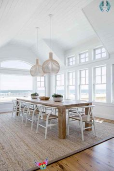 The contrast between crisp, bright white and warm wood that's full of character is a popular move these days. The choice of iconic Danish dining chairs and Finnish pendant lights reinforces the Scandinavian flavor of the room.<br> Beach House Style, Beach House Decor, Diy Home Decor, Room Decor, Beach Houses, Coastal Decor, Beach Cottages, Coastal Cottage, Coastal Farmhouse