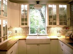 10 Tiny Kitchens We Love  WINDOW CHANGE TO ADD ROOM FOR UPPER CABINETS