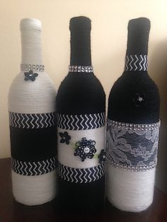 Noir et Blanc Remarkable Vases by HeavenlyChicDesigns on Etsy Glass Bottle Crafts, Wine Bottle Art, Diy Bottle, Bottles And Jars, Glass Bottles, Wine Bottle Centerpieces, Wine Craft, Altered Bottles, Bottle Painting