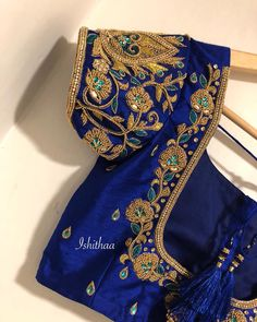 The colour says it all ! Custom made blouse . Beautiful royal blue color designer blouse with floret lata design hand embroidery bead work. Ping on 9884179863 to book an appointment. Cutwork Blouse Designs, Simple Blouse Designs, Stylish Blouse Design, Bridal Blouse Designs, Blouse Neck Designs, Simple Designs, Hand Work Blouse Design, Designer Blouse Patterns, Indie