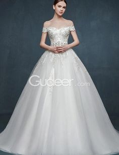 This stunning off the shoulder ball gown long tulle winter wedding dress with lace patterns on the top bodice, sheer tulle flows to the end with embroidered look.