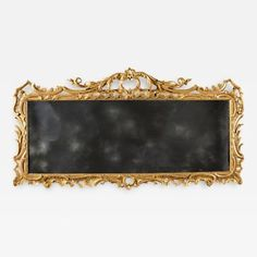 An 18th Century English George II Period Carved Giltwood Overmantel Mirror by