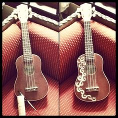 Decided to jazz up my boring solid one dimensional colored ukulele by painting it using Martha Stewart's Pearl Paint.