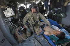 A U.S. Army medic of the C Company 3/82 Dustoff medevac checks an injured Afghan National Army soldier suffering from a gunshot wound, as he is transported in by helicopter in Logar province, eastern Afghanistan, May 16, 2012. (Danish Siddiqui/Reuters)