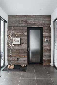 Modern Entryway with High ceiling, ETO Interior Solid White Primed Doors, Stikwood Reclaimed Weathered Wood, Carpet